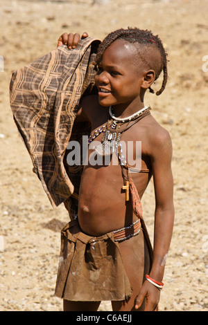 Young Himba girl in village near Opuwo, Namibia - Stock Photo