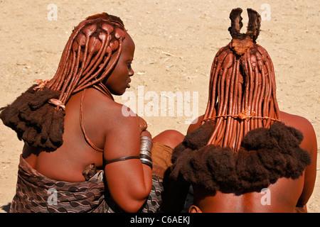 Himba women near Opuwo, Namibia - Stock Photo