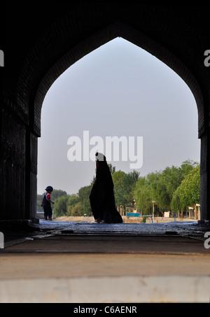 An Iranian Woman walking in public wearing Chadar, Isfahan Iran. - Stock Photo