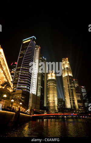 Skyscrapers in the Financial District at night, seen from the river, Singapore - Stock Photo