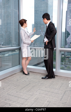 Chatting at the office - Stock Photo