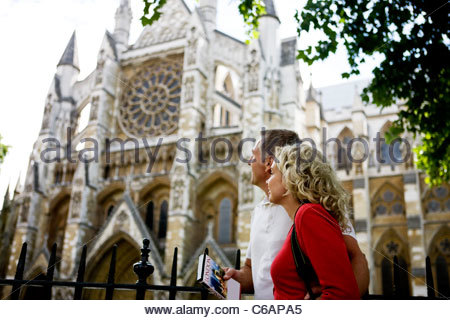 A middle-aged couple looking at Westminster Abbey, London - Stock Photo