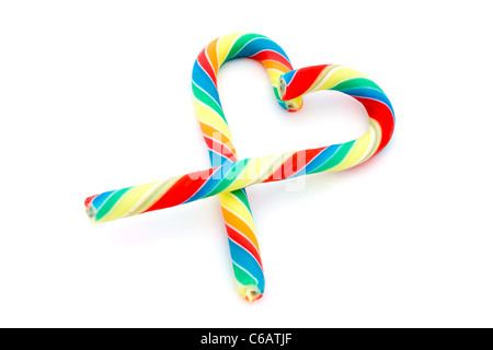 Colourful candy cane heart over white - Stock Photo