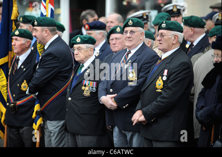 Royal Marines veterans amongst mourners gathered for a repatriation ceremony at Wootton Bassett, Wiltshire UK Dec - Stock Photo