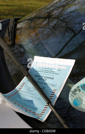 A penalty notice charge (Parking ticket) on a car windscreen. London. UK. - Stock Photo