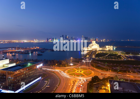 Qatar, Middle East, Arabian Peninsula, Doha, Elevated view over the Museum of Islamic Art and the Dhow harbour - Stock Photo