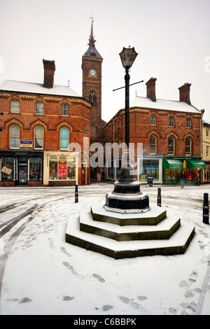 Louth, Lincolnshire, England in the winter snow, snowing, footprint in the market square - Stock Photo