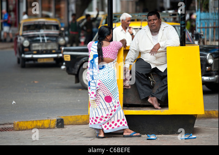 An Overweight Taxi Dispatcher In A Conversation With A Women By A ...
