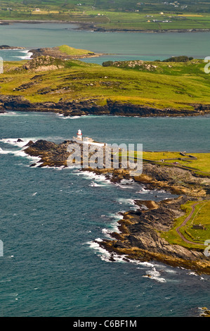The Valentia Island lighthouse in County Kerry, Ireland, viewed from the island's highest point on Geokaun Mountain. - Stock Photo