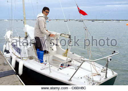 A yachtsman on his boat in Burnham-on-Crouch, Essex, UK. - Stock Photo