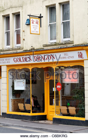 Side on view of the Golden Dragon Chinese take away in Bridport, Dorset, England - Stock Photo