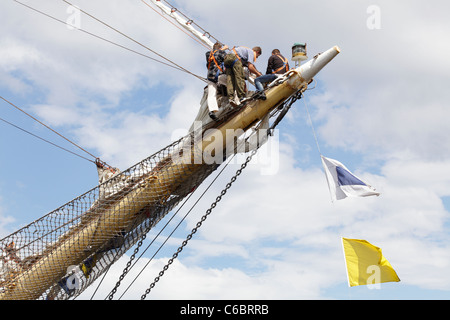 Crew working on a ship berthed at the Tall Ships Race 2011 in Greenock, Scotland, UK - Stock Photo