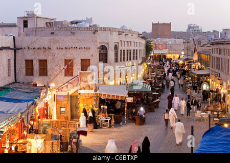 Qatar, Middle East, Arabian Peninsula, Doha, the restored Souq Waqif with mud rendered shops and exposed timber - Stock Photo