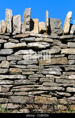 A dry sone wall in Purbeck stone Dorset UK - Stock Photo
