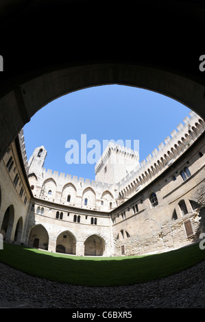 Courtyard of gothic style Palais des Papes (Papal Palace or Palace of the Popes) in Avignon city, Provence region - Stock Photo