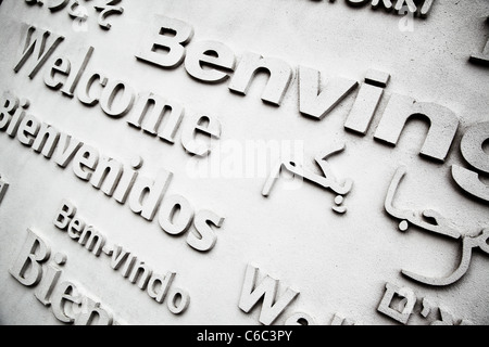 Board with greetings in different languages close up - Stock Photo