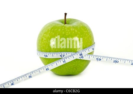 Apple and Measurement Tape Diet Concept - Stock Photo