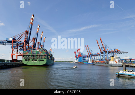 Container ship at the Eurokai Container Terminal, Hamburg, access ramps, loading of overseas shipping containers - Stock Photo