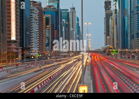 United Arab Emirates, Dubai, Sheikh Zayed Road, traffic and new high rise buildings along Dubai's main road - Stock Photo
