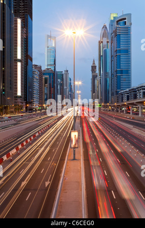 United Arab Emirates, Dubai, Sheikh Zayed Rd, traffic and new high rise buildings along Dubai's main road - Stock Photo