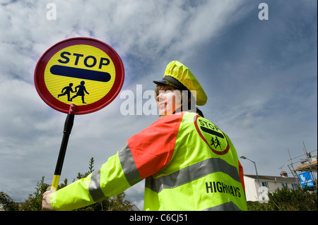 Cornwall's youngest lollipop lady in 2011, 18 year old Tomasina on school crossing patrol. - Stock Photo