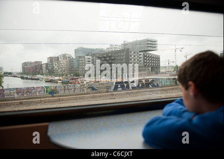 Young Boy looking out of Train Window Amsterdam Netherlands Holland Europe - Stock Photo