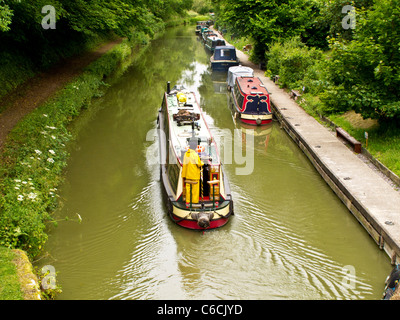 A canal scene with narrowboats near Pewsey Wharf on the Kennet and Avon Canal in Wiltshire, England, UK - Stock Photo