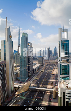 Elevated view over the modern Skyscrapers along Sheikh Zayed Road looking towards the Burj Kalifa, Dubai, United - Stock Photo