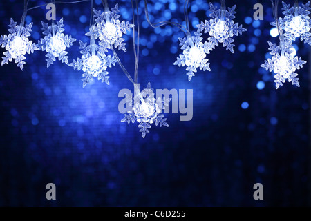 Christmas snowflake lights with copyspace. - Stock Photo