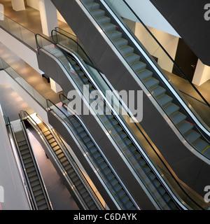 Many escalators inside Dortmunder U cultural centre in Dortmund in Germany - Stock Photo