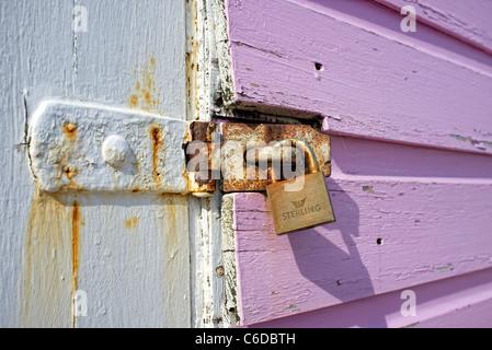 padlock on a painted wooden door - Stock Photo