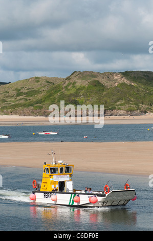 Holidaymakers on the ferry travelling from Rock to Padstow in Cornwall, England. - Stock Photo