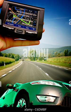 Grate car on the highway. gps in a man hand - Stock Photo