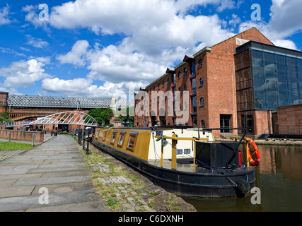 Narrow boat tied up on the Bridgewater Canal in central Manchester - Stock Photo