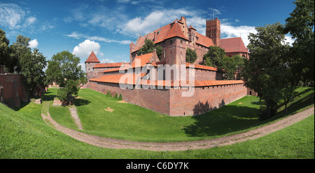 Panoramic view of the Teutonic Order's castle in Malbork from its south corner. One row panorama with 145 gr. horizontal - Stock Photo