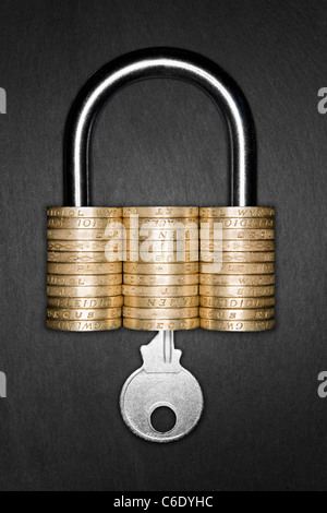 Padlock made form pound coins signifying Financial Security. Key inserted into padlock - Stock Photo