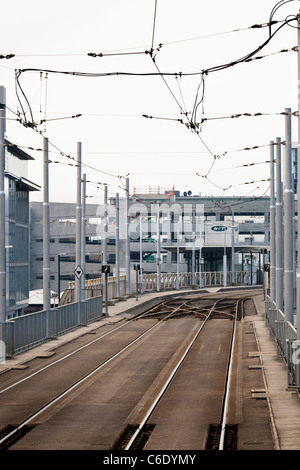 Tramlines and overhead catenary on the approach to Station Street tram stop in Nottingham, England, UK - Stock Photo