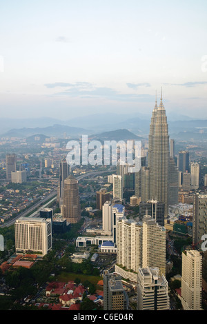 Petronas Twin Towers, view from Menara TV Tower, fourth largest telecommunications tower in the world, Kuala Lumpur, - Stock Photo