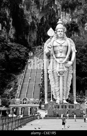 statue of the god Murugan at the forecourt of the Batu Caves, limestone caves near Kuala Lumpur, Malaysia - Stock Photo