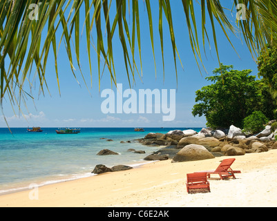 Red deck chairs on the beach of Panuba, Pulau Tioman Island, Malaysia, Southeast Asia, Asia - Stock Photo