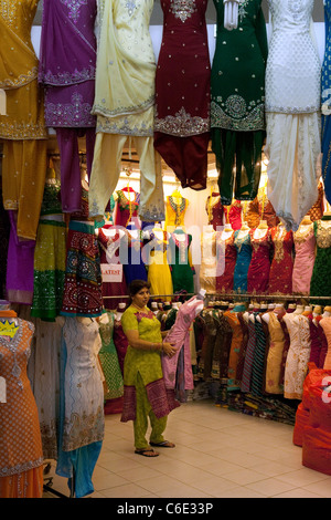 a shopping for clothes in the tekka centre market