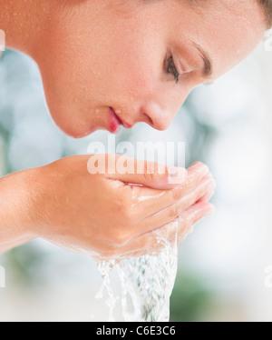 Woman washing face - Stock Photo