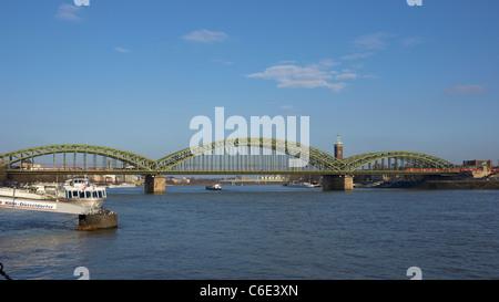 Hohenzollern steel frame railway bridge over the river Rhine in Cologne, Germany - Stock Photo