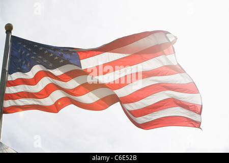 USA, New York State, New York City, American flag against sky - Stock Photo