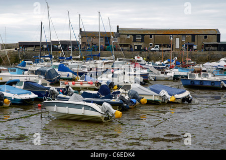 The harbour at Lyme Regis, Dorset, England at low tide. - Stock Photo