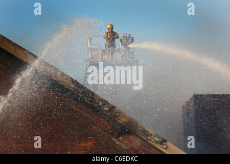 Fire Fighters working on the Factory Fire at Stuart Crystal Factory in Camp Hill Wordsley. West Midlands Fire Service - Stock Photo