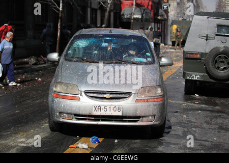 Damaged car during a student strike in Santiago's Downtown, Chile. - Stock Photo