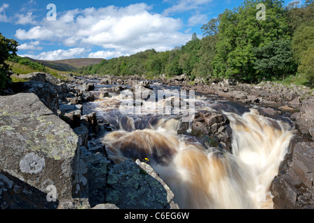 Gushing water of the River Tees, over High Force Waterfall in Teesdale, County Durham - Stock Photo