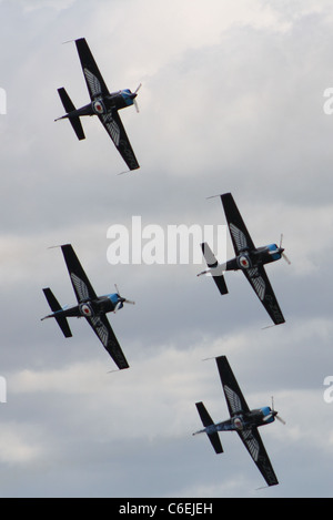 blades aerobatic display team flying in formation - Stock Photo