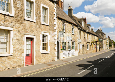 Houses and shops on a street in the Gloucestershire village of Fairford - Stock Photo